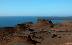 Spatter Cones. Volcanic spatter cones at The Galapagos Islands, with ocean in the background Royalty Free Stock Image