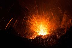 Spattering of Stromboli volcano erupting with Lava. Spattering Eruption on Stromboli Volcano with lava Stock Photo