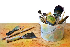 Spatula and bucket with brushes Stock Image