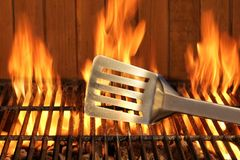 Spatula Close-up On The Hot Flaming BBQ Grill Royalty Free Stock Image