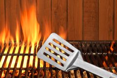 Spatula Close-up On The Hot Flaming BBQ Grill Stock Image