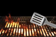 Spatula on the Flaming BBQ Grill Royalty Free Stock Photos