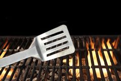 Spatula on the Flaming BBQ Grill Stock Photo