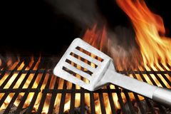 Spatula on the Flaming BBQ Grill Stock Photography