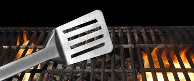 Spatula On The Hot Flaming BBQ Grill Close-up Stock Images