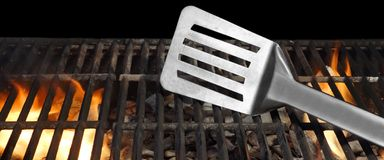 Spatula On The Hot Flaming BBQ Grill Close-up Stock Photography