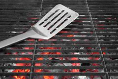 Spatula on the Hot Grill Royalty Free Stock Photography