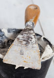 Spatula with plaster and mixing tub Stock Photo