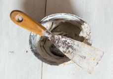 Spatula with plaster and mixing tub Royalty Free Stock Images