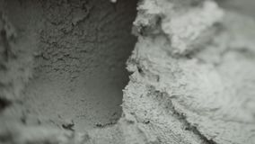 Spatula scooping the cement stock footage