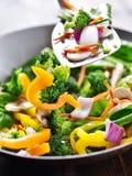 Spatula stirring vegetables in a stir fry wok. Stock Photo