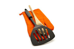 Spatula with Wooden Cooking Spoon and red potholder Royalty Free Stock Photo