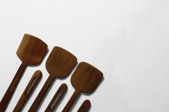 Spatule en bois avec le fond blanc photos stock