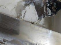 Spatule et plâtre image stock