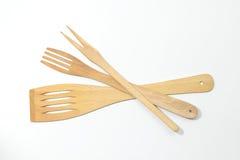 Spatules en bois et fourchettes d'isolement Images stock