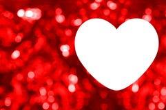 Spazio in bianco della cartolina d'auguri con il fondo rosso del bokeh Fotografia Stock Libera da Diritti