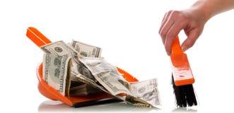 Spazza i soldi nel mestolo Fotografie Stock