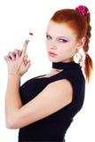 Spazzola attraente della holding della donna Fotografia Stock Libera da Diritti