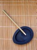 Spazzola cinese della penna sulla pietra dell'inchiostro Immagine Stock Libera da Diritti