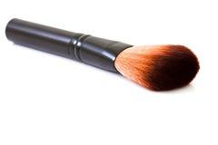 Spazzola cosmetica isolata su fondo bianco Fotografia Stock