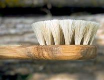 Spazzola di legno con una maniglia Fotografie Stock