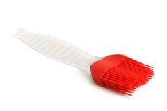 Spazzola di pasticceria rossa del silicone Fotografie Stock