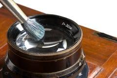 Spazzola di pulizia dell'obiettivo Fotografie Stock Libere da Diritti