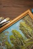Spazzola e pittura sul legno fotografia stock