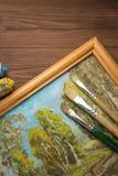 Spazzola e pittura sul legno immagini stock