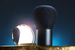 Spazzola e specchio Fotografia Stock