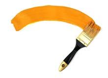 Spazzola e vernice gialla Fotografie Stock