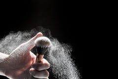 Spazzola nera spessa nel moto e nelle particelle sciolte della polvere sparsi intorno fotografia stock libera da diritti