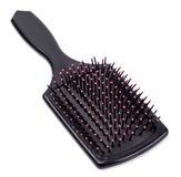 Spazzola per capelli Fotografie Stock