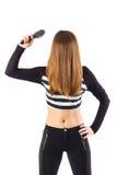 Spazzola per capelli esagerata della tenuta della donna Immagine Stock
