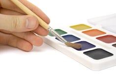Spazzola per la pittura e la mano Fotografia Stock