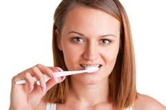 Spazzolatura di denti Fotografie Stock