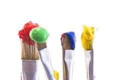 Spazzole con pittura isolata su bianco Fotografia Stock