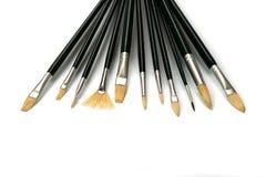 Spazzole di pittura su fondo bianco Fotografie Stock