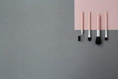 Spazzole rosa grige di volto della geometria Fotografia Stock
