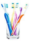 Spazzolini da denti e spazzola interdental in vetro trasparente Fotografia Stock Libera da Diritti