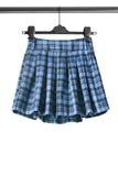 Spódnica na ubrania stojaku Obrazy Royalty Free
