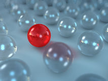 The speacial one. Group of glass balls with one different, red one in between vector illustration