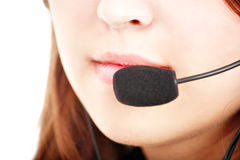 Speak. Beautiful customer-servise operator with a headset royalty free stock photography