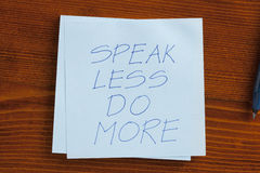 Speak less do more written on a note Royalty Free Stock Photo