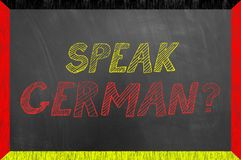Speak German text on flag frame chalkboard. Or blackboard as foreign language vocabulary school university lesson concept royalty free stock photo