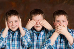 Speak hear see no evil. Teenager boy pretending to see hear and speak no evil royalty free stock images