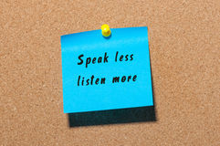 Speak Less Listen More sticker pinned at notice board background Royalty Free Stock Photos