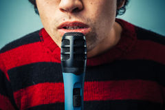 Speak into the microphone Stock Photography
