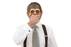 Speak no evil. Businessman in monkey mask Stock Photography