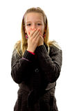 Speak no evil. Young blonde girl covers her mouth: speak no evil, isolated on white background Royalty Free Stock Images